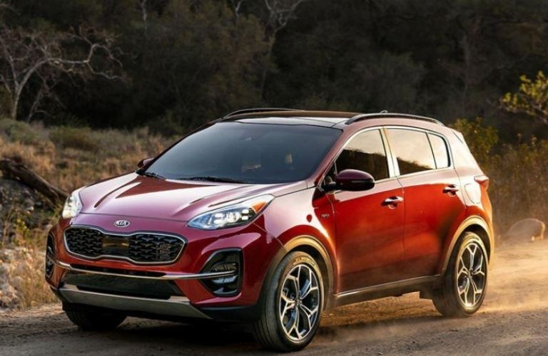 2020 Kia Sportage driving on dirt and sand