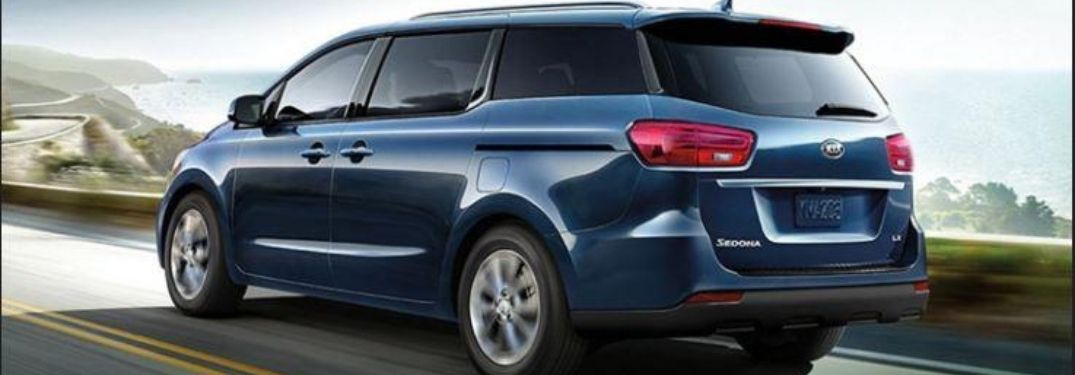 2021 Kia Sedona driving rear side view driving