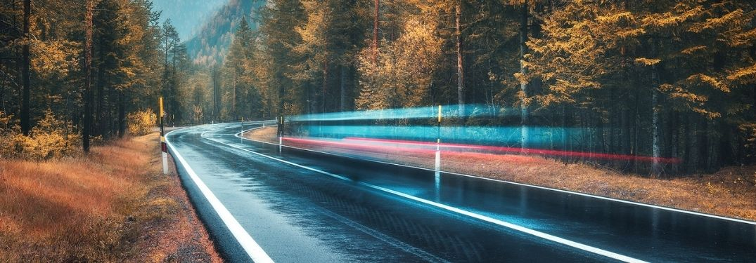 Fall road with a blurred vehicle