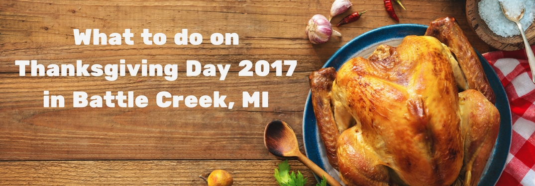 Turkey and spices on a wooden table with text reading What to do on Thanksgiving Day 2017 in Battle Creek MI