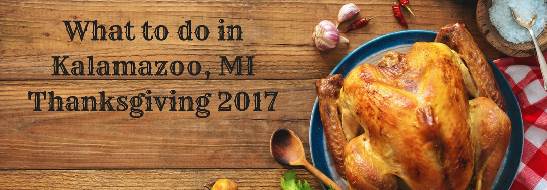What to do in Kalamazoo, MI thanksgiving 2017 text next to a turkey on a wooden table