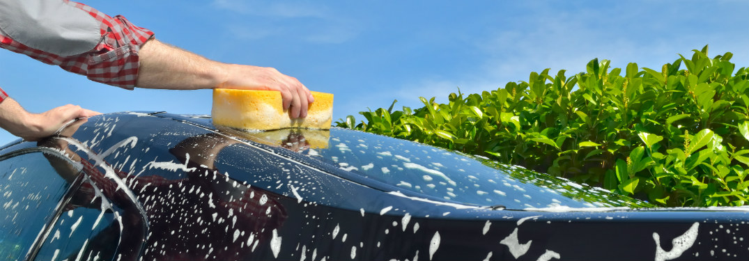 arm waxing car with a sponge