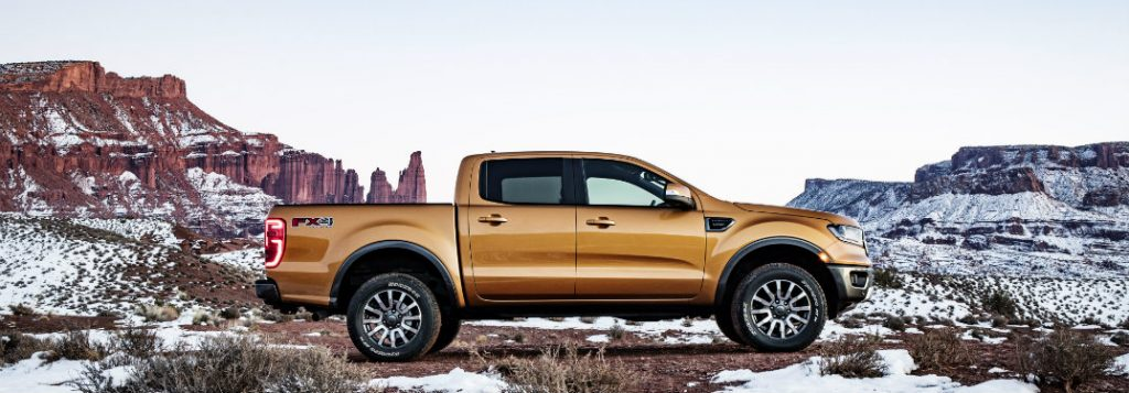 2019 ford ranger side view parked by mountain