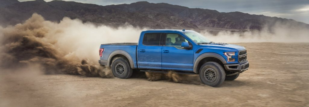 2019 ford f-150 raptor full side view while off-road driving