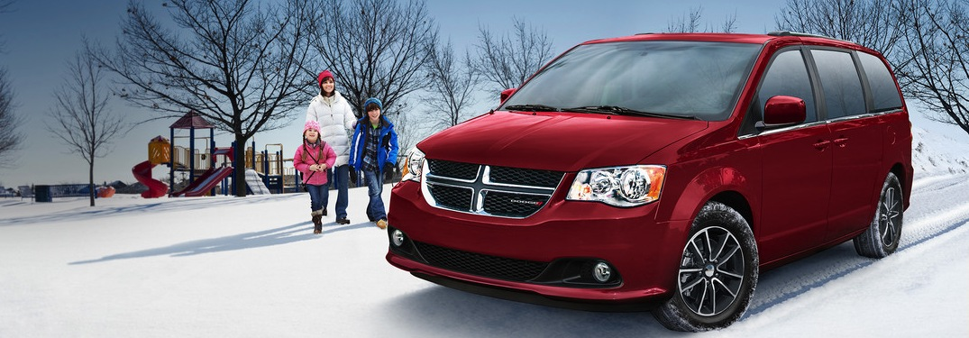 2019 Dodge Grand Caravan red in snow