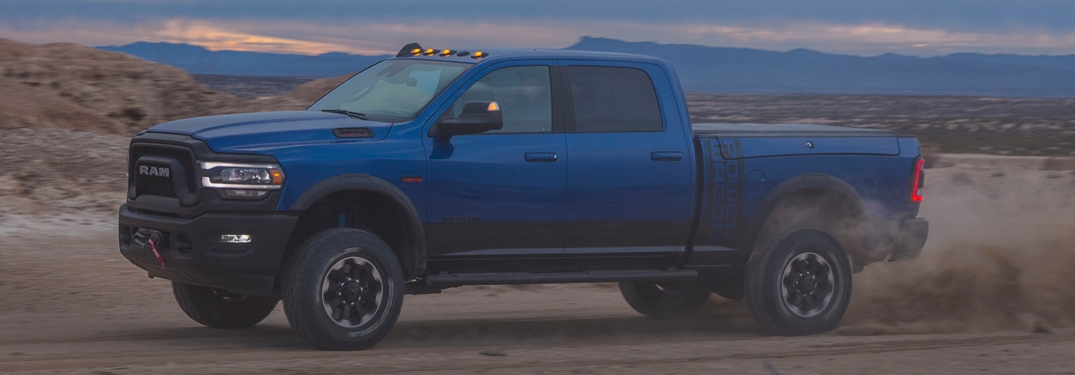 2019 RAM Heavy Duty blue side view in sand