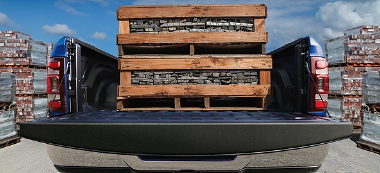 2019 RAM 3500 blue rear view with bed fully loaded