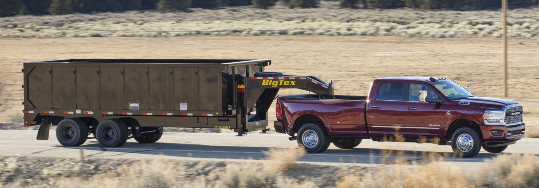2019 RAM 3500 red side view towing a trailer