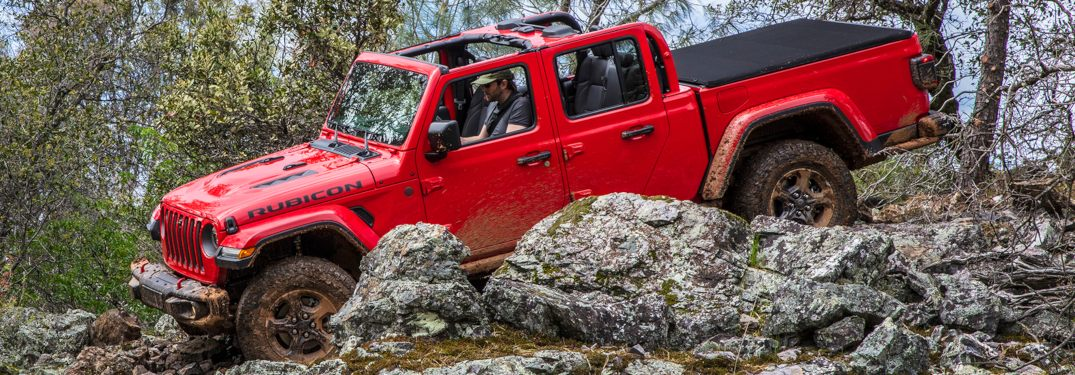 2020 Jeep Gladiator red side view top off in rocks