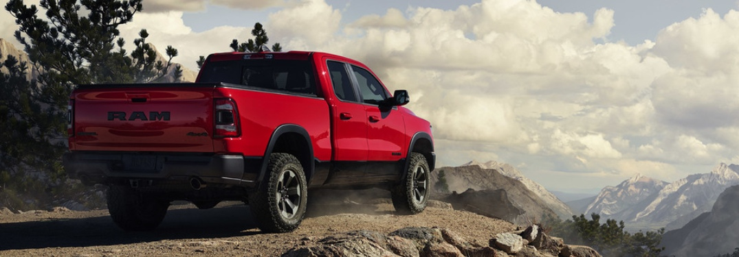 2020 RAM 1500 red back view on a cliff