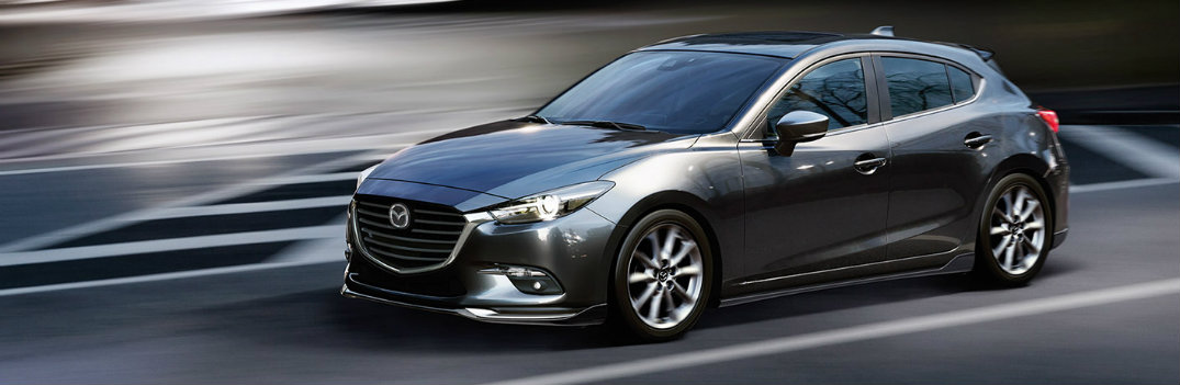 2018 Mazda3 hatchback titanium color driving in blur