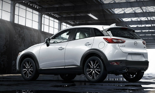 2018 Mazda CX-3 white back exterior parked in an empty warehouse
