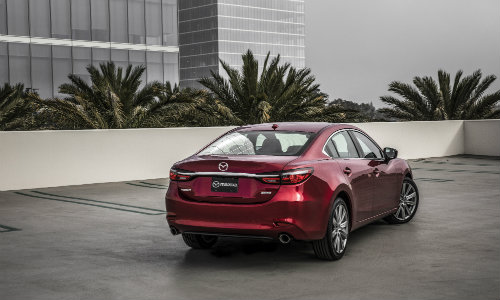 2018 Mazda6 exterior shot back bumper and trunk rear parked on top of skycraper roof cityscape near ferns