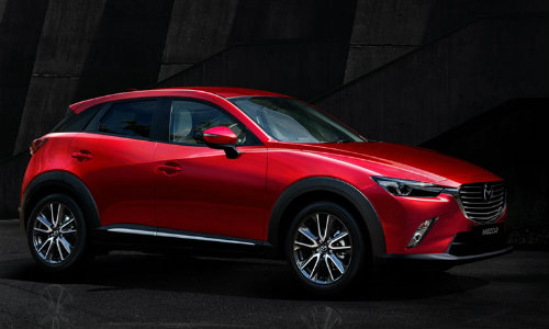 2018 Mazda CX-3 compact SUV exterior side shot in a dark showcase room