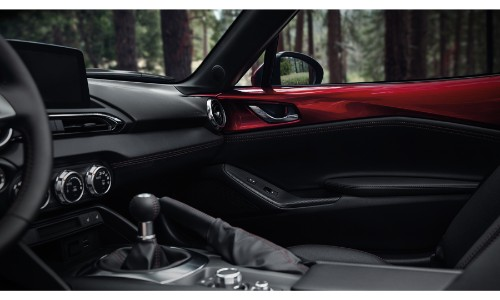 2019 Mazda MX-5 Miata interior shot of front passenger seat showing upholstery, interior accents and trimming, and dashboard technology