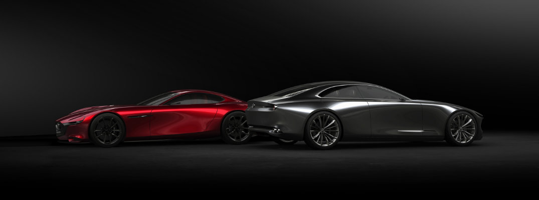 Mazda KAI CONCEPT and VISION COUPE showcase exterior side shot while presented