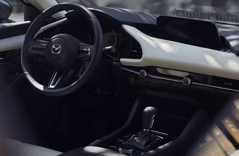 2020 Mazda3 dash and wheel represented by the 2019 model