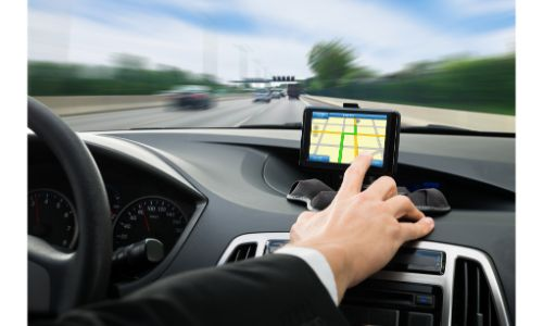 Hand reaching out to use a navigation system