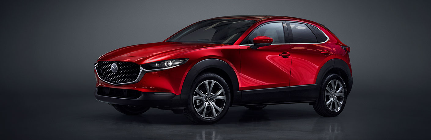 A front and side view of a red 2020 Mazda CX-30