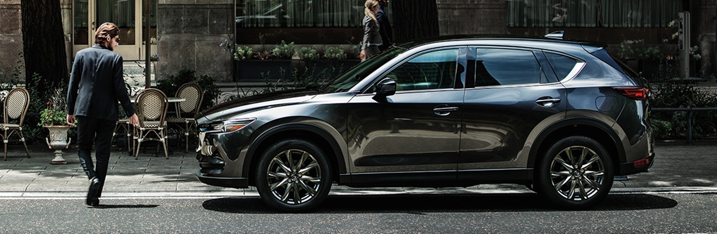 A 2020 Mazda CX-5 parked on a city road.